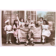 French RPPC, The Wedding Feast, Children Toast the Doll Bride and Groom, Hand Tinted Real Photo Postcard, Circa 1910s