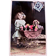 Tinted RPPC, Little Girl, Pink Pram, Smiling Doll, Wine Bottles and Flowers, French Real Photo Postcard Postmarked 1908