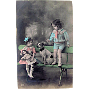 Tinted RPPC, Little Girl With Doll, Little Boy With Dog, Circa Early 1900s, French Postcard