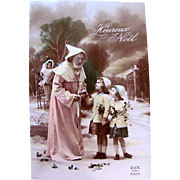 French Tinted Real Photo Postcard, Santa in Pink Robe, Beautiful Doll, 2 Little Girls, Heureux Noël, Circa 1930s