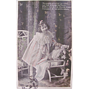 Hand Tinted French Real Photo Postcard, Little Girl, Beautiful Doll and Flowers, Postmarked 1910
