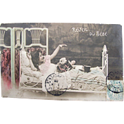 Tinted French Real Photo Postcard, The Baby Awakens, Little Girl in Bed with Doll, Stuffed Toy, Tin Pail, Postmarked 1906