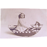 British Real Photo Postcard, Girl and Doll In Boat, Dames at Sea, Circa 1930s