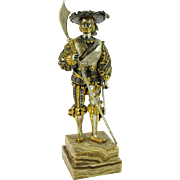 Gilt and Silvered Bronze Signed Sculpture of a Cavalier on Stepped Marble Base.