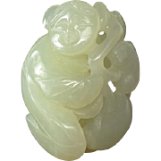 Carved White Jade Child With Lingzhi Toggle