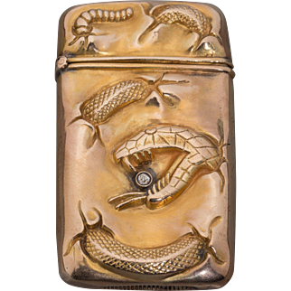 An Unusual American Gold and Diamond Snake Motif Match Safe, circa 1900 - The Serpent Holds A Bezel Set Diamond In Its Mouth.