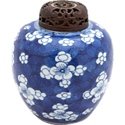 Chinese Blue and White Ginger Jar With Prunus (Plum Blossom) Decoration  And A Carved Wood Lid