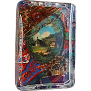 Unusual Paperweight - A Three Dimensional Scene Encased in Glass With Flowers and A Frame Surrounding A Bucolic Scene, With Buildings, Sheep, Shepherd, Clouds -