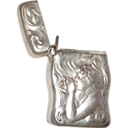 Unger Sterling Silver Shaped Match Safe (Vesta) With Repousse Decoration Of A Woman Lighting A Cigarette