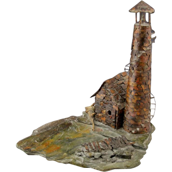 Copper Lighthouse Sculpture On Slate Rock