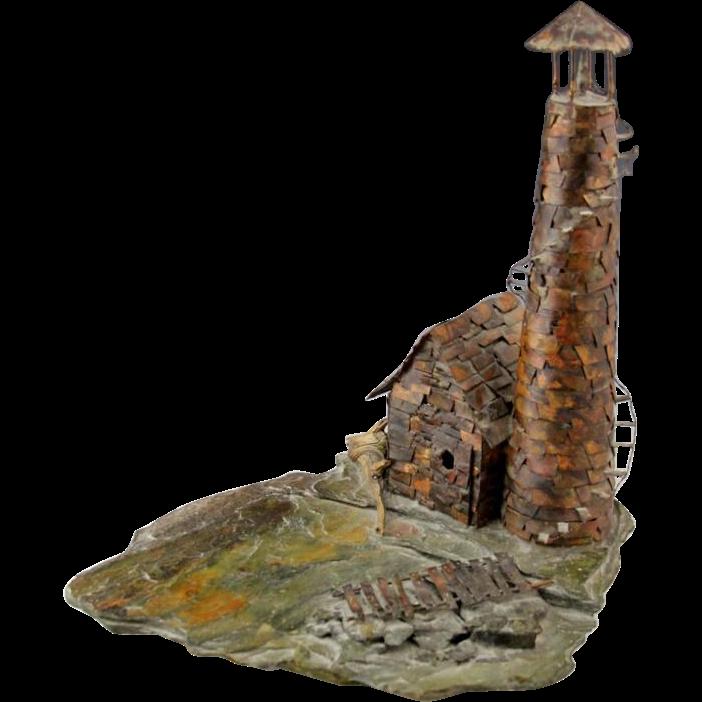 Copper Lighthouse Sculpture On Slate Rock