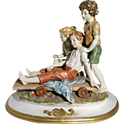 "Multi-Figural Bisque Porcelain ""Winter Fun"" Three Children With A Sled"