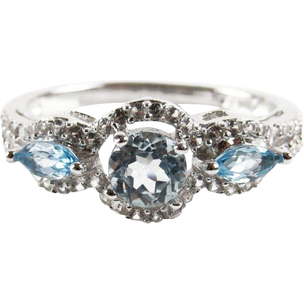 Sterling Silver and Round Sky Blue Topaz Center Stone Accented with Marquise Cut Sky Blue Topaz and White Sapphire Ladies Ring