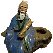 Chinese Mudman Larger Seated Sage Holding An Unusual Musical Instrument. With Calligraphy Brush Washer