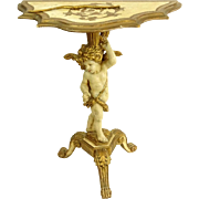 Florentine Carved, Painted and Parcel Gilt Pedestal Console with Figural Cupid Base.