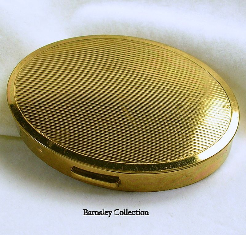 Signed Henri Bendel, Vintage Oval Gold Tone Compact with Mirror