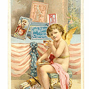 VICTORIAN Trade Card - Wilbur's Breakfast Chocolate - Cupid Drinking Hot Cocoa!