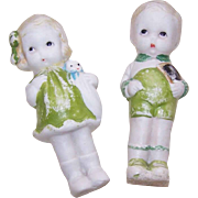 C.1960 Made in Japan Porcelain Dolls - Little Boy & Girl Dressed in Green!