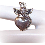 Sweet STERLING SILVER Charm or Pendant - Angel Leaning on a Heart!