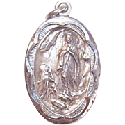 Vintage STERLING SILVER Religious Charm or Medal - Saint Bernadette & The Virgin Mary at Lourdes!