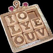 RARE C.1970 Dankner 14K Gold & .12CT TW Ruby Mechanical Charm or Pendant - Sliding Puzzle Reading I LOVE YOU!