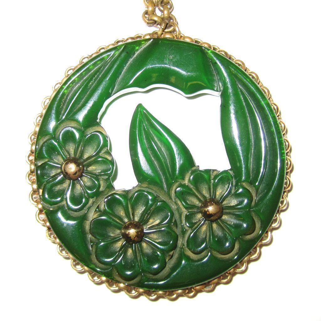 Translucent Green Bakelite Floral Carved Pendant