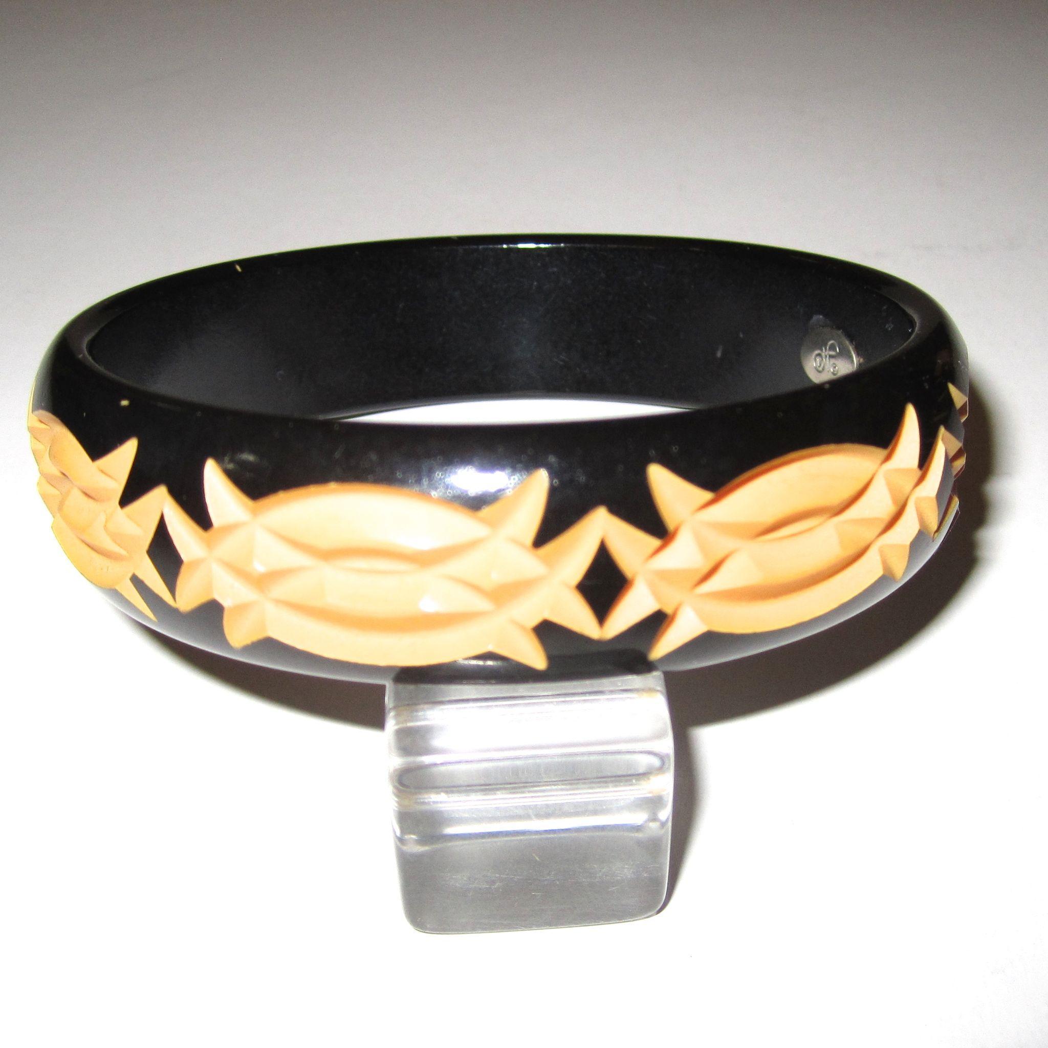 Diane von Furstenberg signed Cut-Back Carved Bakelite Bangle Bracelet