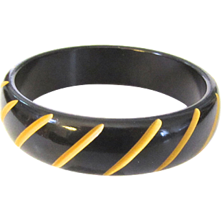 Black and Cream Carved Cut-Back Bakelite Bangle Bracelet