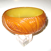 Translucent Butterscotch or Apricot Carved Bakelite Bangle Bracelet