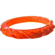 Heavily Carved and Pierced Apricot Bakelite Bangle Bracelet