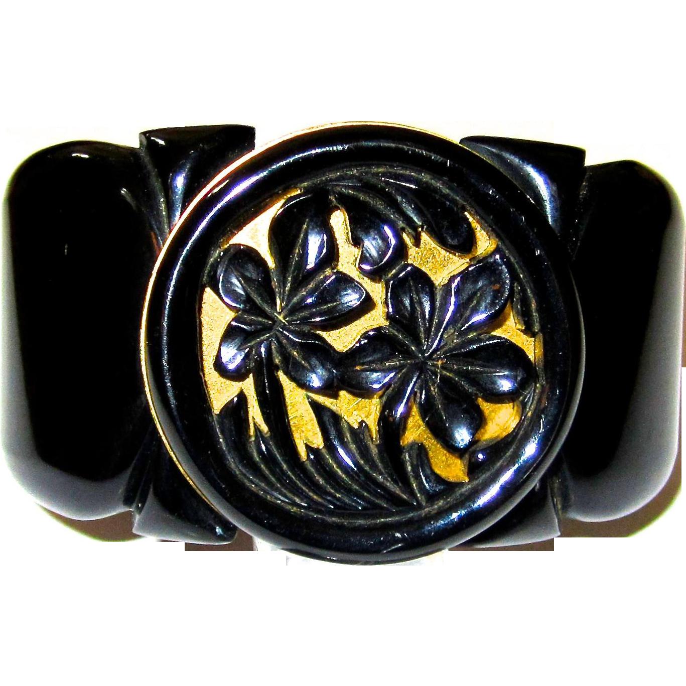 Impressive Black Bakelite Hinge Bracelet with Carved Medallion