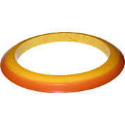 Laminated Two-Tone Bakelite Flying Saucer Bangle Bracelet