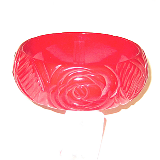 Bright Red Bakelite Bangle with Floral Carving