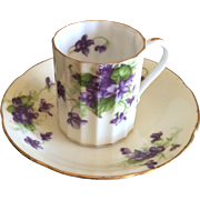 Vintage porcelain demitasse cup and saucer with violets