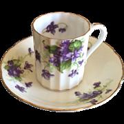 Vintage porcelain demitasse cup and saucer with violets