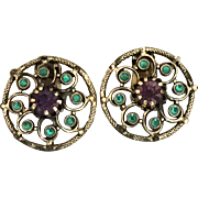 Vintage Freirich goldtone purple and green rhinestone clip on earrings