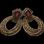 Vintage hinged goldtone hoop earrings with light red stone pierced
