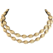 Vintage Monet twisted brushed goldtone bead double strand choker