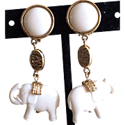 Dangling white elephant earrings