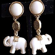 Dangling white elephant earrings
