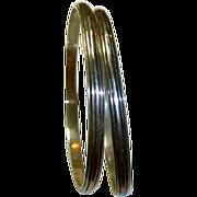 A Pair of Vintage Sterling Silver Bangle Bracelets