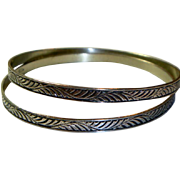A Vintage Pair of Matching Sterling Silver Bangle Bracelets
