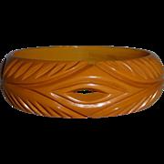 Bakelite Carved & Pierced Butterscotch Bangle Bracelet