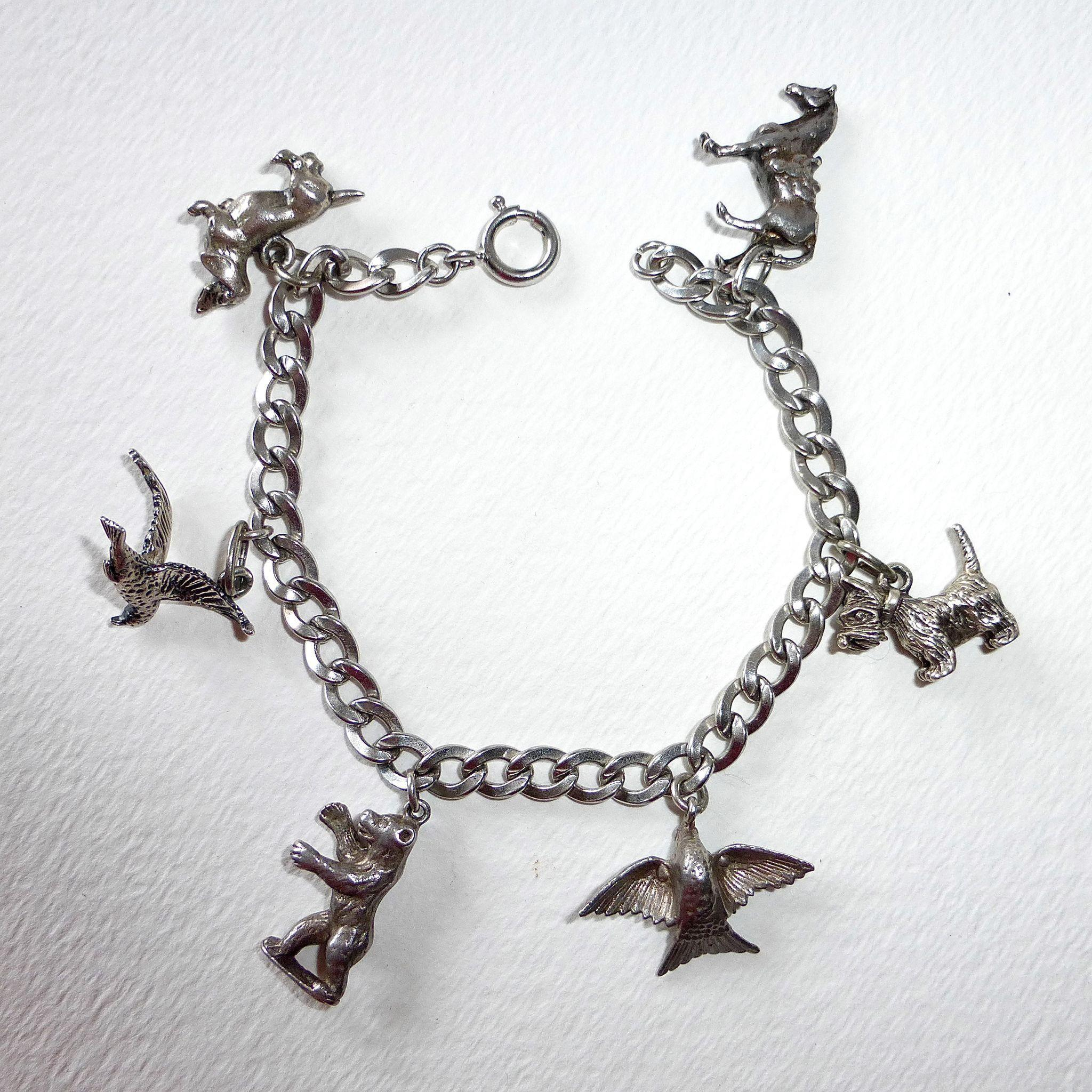 beau sterling silver animal charm bracelet from bejewelled on ruby