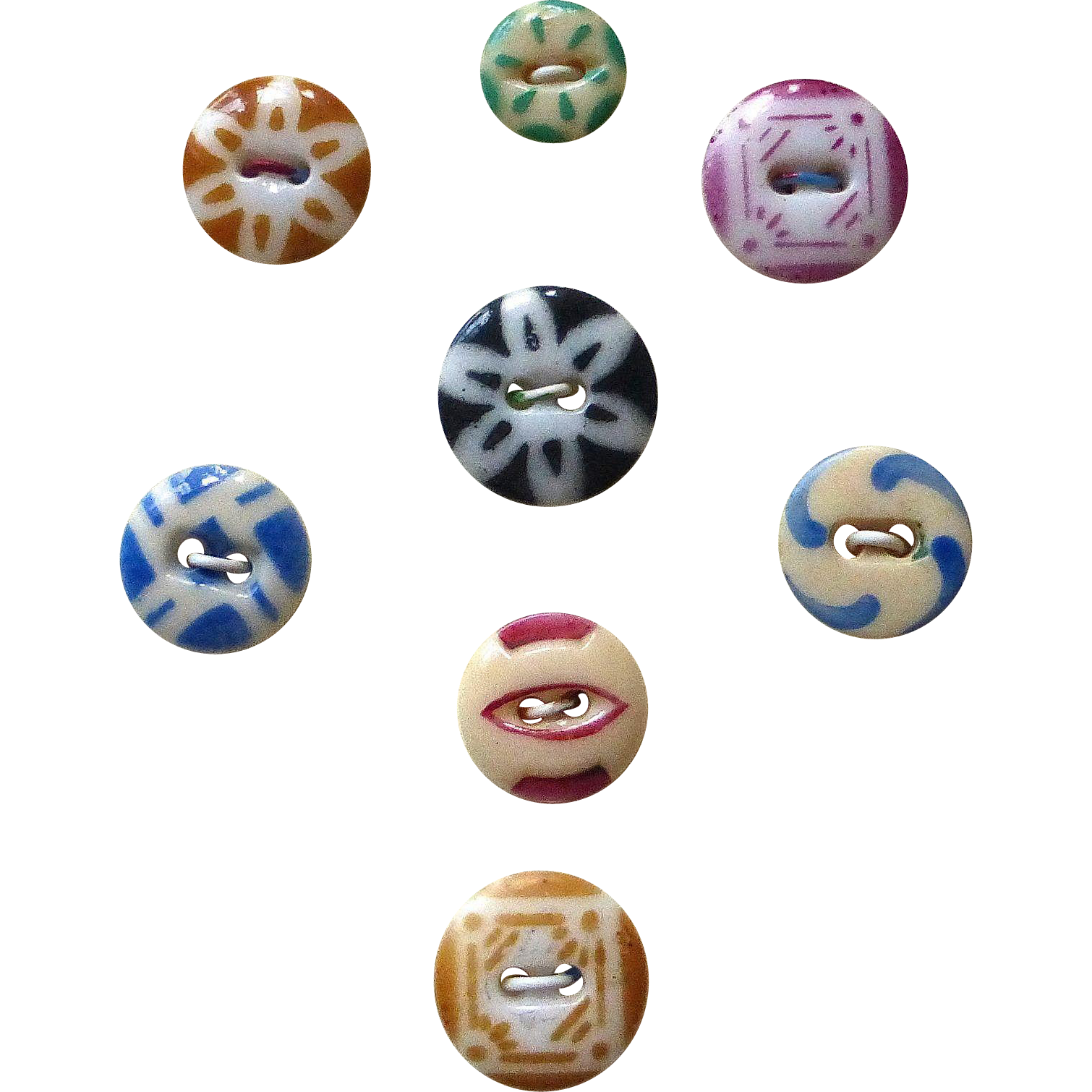 Eight Vintage China Color Stencil Buttons
