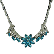 Ora Rhodium Plated Rhinestone Necklace w Aqua Floral Centerpiece