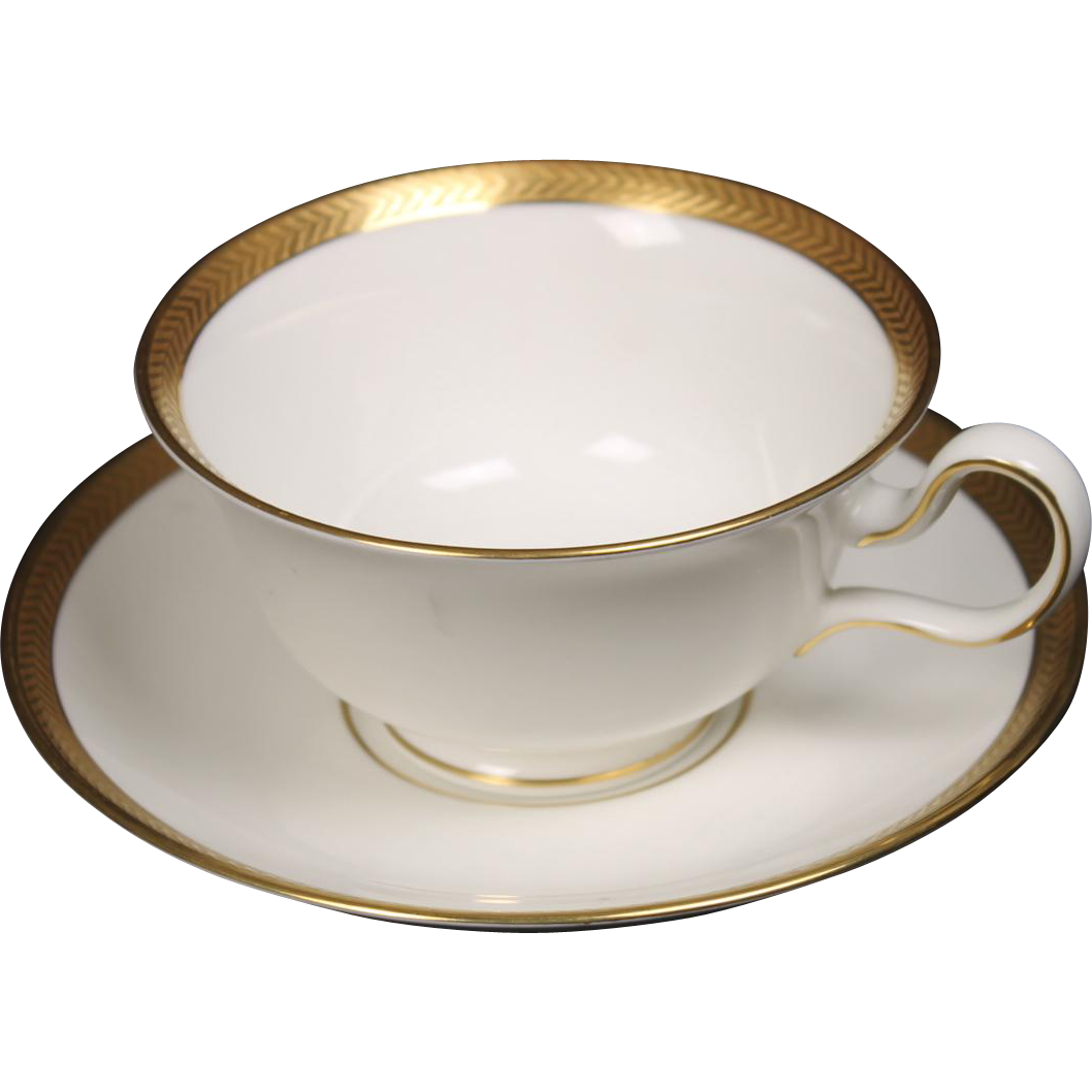 Wedgwood ''Senator'' Cup and Saucer Set (Peony Handle) with a beautiful gold encrusted laurel band.  2-1/4''