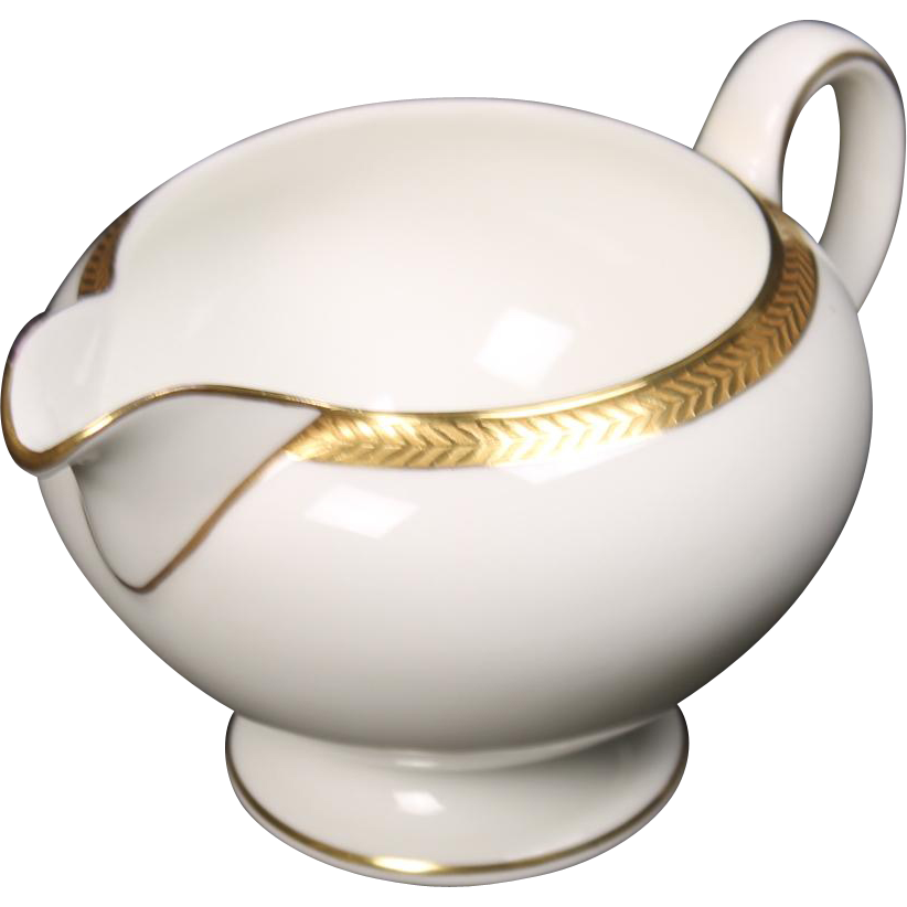 Wedgwood ''Senator'' Leigh shaped Creamer with a beautiful gold encrusted laurel band.  3-1/4''