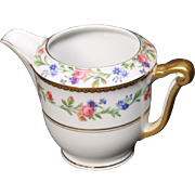 Beautiful French Limoges Creamer from Raynaud & Co.  Mixed Floral Pattern with Gold Trim.