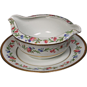 Beautiful French Limoges Gravy with Attached Underplate from Raynaud & Co.  Mixed Floral Pattern with Gold Trim.